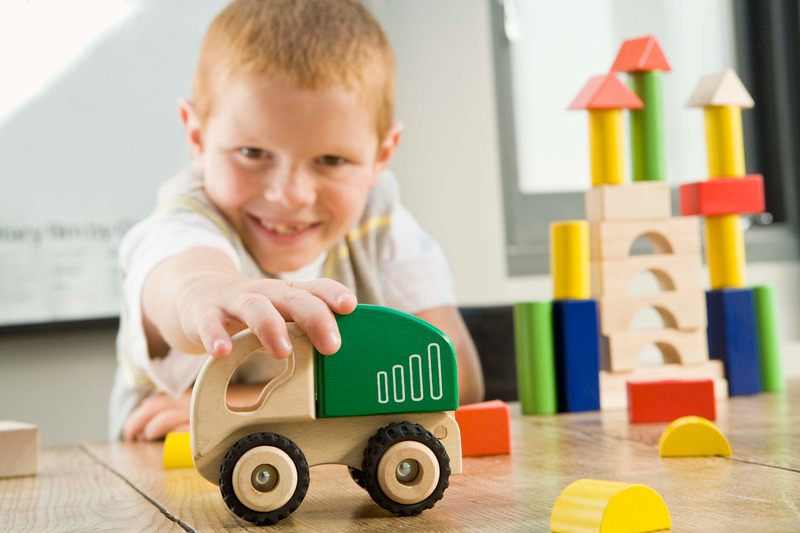 blue mountains playgroups boy playing with wooden truck St Finbar's Glenbrook Playgroup
