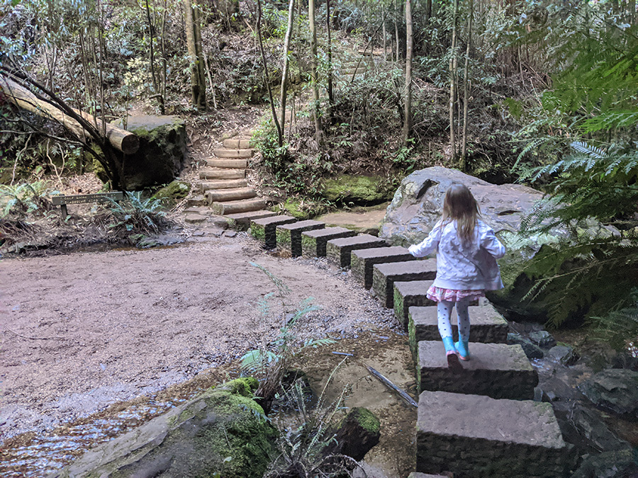 Little girl is active outdoors on a bushwalk in the Blue Mountains