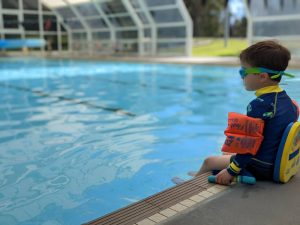 glenbrook pool water play safety little boy on the edge in safety gear
