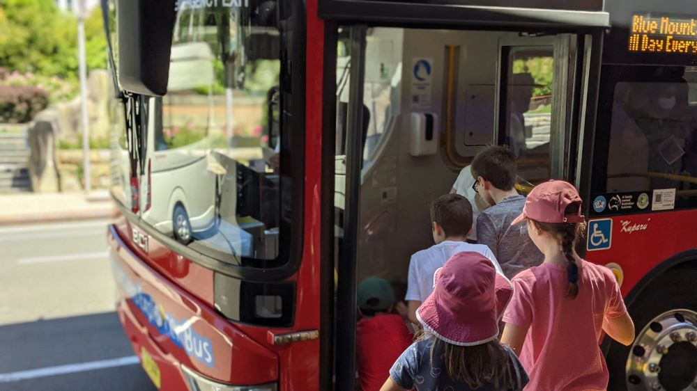 very excited children hopping on the blue mountains explorer bus