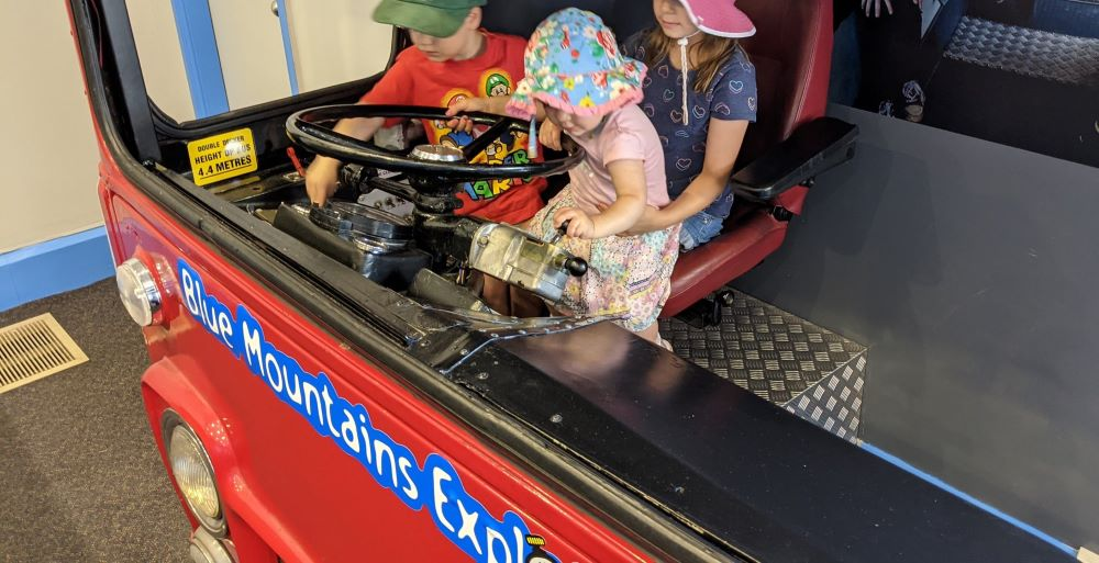 children driving the blue mountains explorer bus